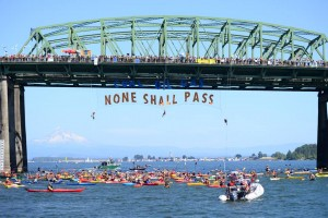 Kayaks across the Columbia river yesterday: a symbolic flotilla against proposed fossil fuel exports that would mean game over for our climate